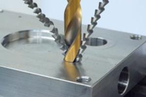 This image is an example of our procedures, it shows a drill bit cutting into aluminium. Fusion Engineering Services, sherburn in elmet, north yorkshire.